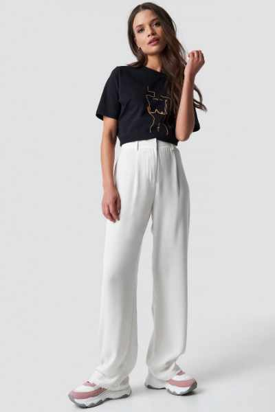 Emilie Briting x NA-KD Flowy Pants - White